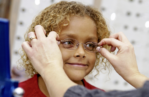 Fitting child with glasses
